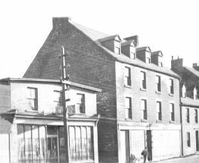 James Cron's draper shop (left)